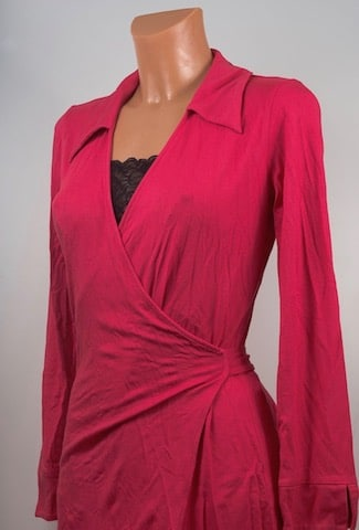 rayon, fashion and deforestation, clothing, viscose. Pink red viscose wrap dress with long sleeves and v-neck. viscose is a type of rayon.